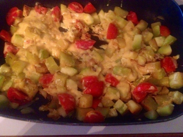 Scrambled tomato, zucchini and onion.  The eggs are almost cooked so the meal is almost ready to eat.